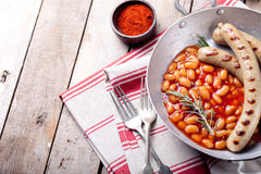 Grilled sausages with beans in tomato sauce Royalty Free Stock Photo