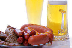 Grilled sausages with beer Royalty Free Stock Photos
