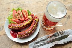 Grilled sausages with beer Stock Image