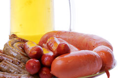 Grilled sausages with beer mug Stock Photography