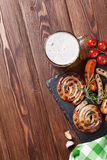 Grilled sausages and beer mug Royalty Free Stock Photo