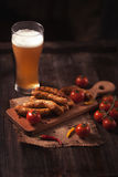 Grilled sausages with beer Royalty Free Stock Photo
