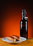 Grilled sausages and beer Stock Images
