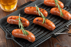 Grilled sausages and beer Stock Photos