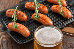 Grilled sausages and beer Stock Photography