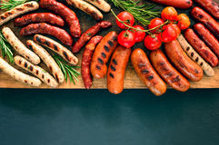 Grilled sausages on a board royalty free stock photo
