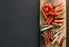 Grilled sausages on a board stock image