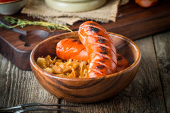 Grilled sausages with cabbage, tomato Stock Photo