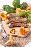 Grilled sausages with chanterelle Royalty Free Stock Photo