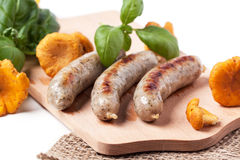 Grilled sausages with chanterelle Stock Photos
