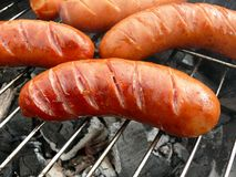 Grilled sausages close-up Stock Images