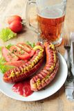 Grilled sausages with cold beer Royalty Free Stock Photo