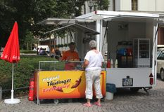 Market stand with grilled sausages, German cuisine, Weimar, Germany  Stock Photo