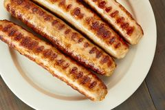 Grilled sausages on dish Royalty Free Stock Photo