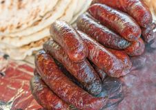 Grilled sausages on a fair stall Royalty Free Stock Photo
