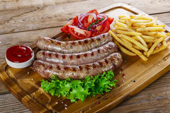 Grilled sausages with french fries Stock Image