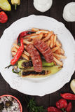 Grilled sausages and french fries Stock Image