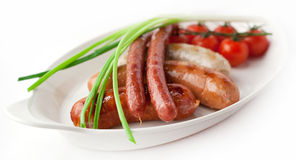Grilled sausages with fresh onions Stock Photography