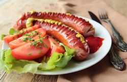 Grilled sausages with fresh tomatoes Stock Photo