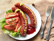 Grilled sausages with fresh tomatoes Stock Photography