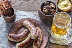 Grilled sausages with fried bacon rashers and mushrooms Stock Images