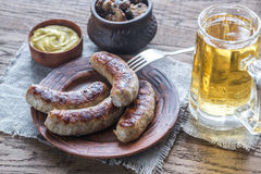 Grilled sausages with fried mushrooms Royalty Free Stock Photos