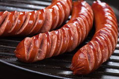 Grilled sausages. Grilled german sausages in grilling pan, close-up image Royalty Free Stock Images