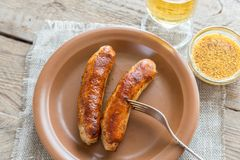 Grilled sausages with glass of beer Royalty Free Stock Image