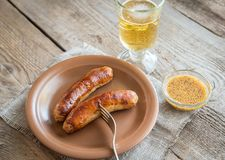 Grilled sausages with glass of beer Stock Photography