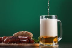 Grilled sausages with glass of beer Stock Images