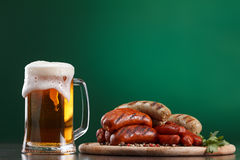 Grilled sausages with glass of beer Stock Image