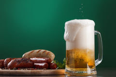 Grilled sausages with glass of beer Royalty Free Stock Photography
