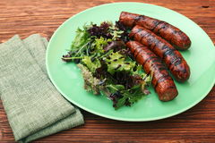 Grilled sausages with greens Stock Image
