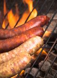 Grilled sausages on the grill Stock Image