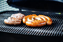 Grilled sausages on the grill Stock Photos