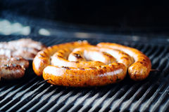 Grilled sausages on the grill Royalty Free Stock Images