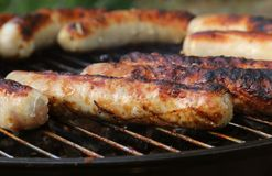Grilled sausages on a grill. Outdoor cuisine royalty free stock photo