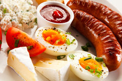 Grilled sausages. Group of grilled sausages, eggs and cheese stock photography