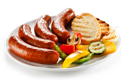 Grilled sausages. Group of grilled sausages and mustard royalty free stock photo
