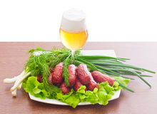 Grilled sausages with herbs and beer Royalty Free Stock Photography