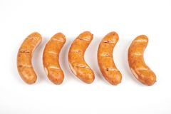 Grilled sausages isolated on a white background stock image