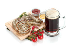 Grilled sausages with ketchup, mustard Royalty Free Stock Photos