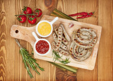 Grilled sausages with ketchup and mustard Stock Photos
