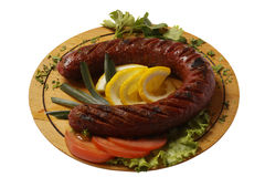 Grilled sausages and lemon Royalty Free Stock Photo
