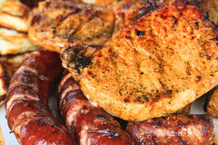 Grilled sausages and meat Stock Image