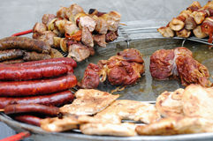 Grilled sausages, meats and kebabs Royalty Free Stock Images