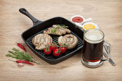 Grilled sausages and mug of beer Royalty Free Stock Photo