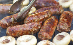 Grilled sausages and mushrooms Royalty Free Stock Photo