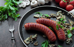 Grilled sausages and mushrooms Stock Photo