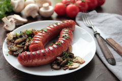 Grilled sausages with mushrooms Stock Image